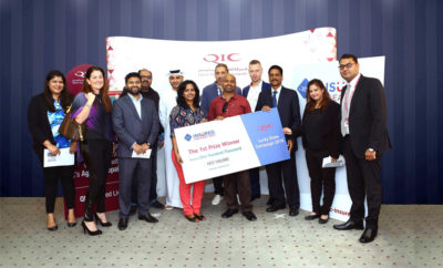 QIC officials handover the cheque to the 1st prize winner of the Lucky Draw campaign 400x242 - QIC Insured Names 11 Winners of Lucky Draw Campaign