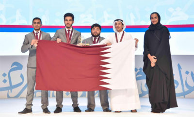 From right to left Her Excellency Abdurrahman Al Qabisi Baara Darar Anas Rasras and Hamed Hussein 400x242 - Qatari Team Crowned Champion of the Fourth Edition of the International Universities Arabic Debating Championship