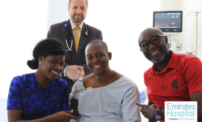Sylvester E nigerian patient with his family and Dr Allam Alkowatli Photo AETOSWire 1526381078 2 400x242 - Rare Cardio Balloon Valvuloplasty Surgery Saves Nigerian Man's Life At Emirates Hospital