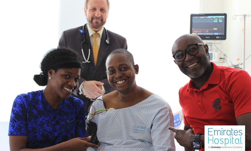 Sylvester E nigerian patient with his family and Dr Allam Alkowatli Photo AETOSWire 1526381078 2 - Rare Cardio Balloon Valvuloplasty Surgery Saves Nigerian Man's Life At Emirates Hospital