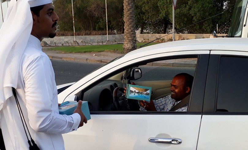 Image 1 - Sealine Beach Resort volunteers distribute  iftar for motorists in Mesaieed and Al Wakrah